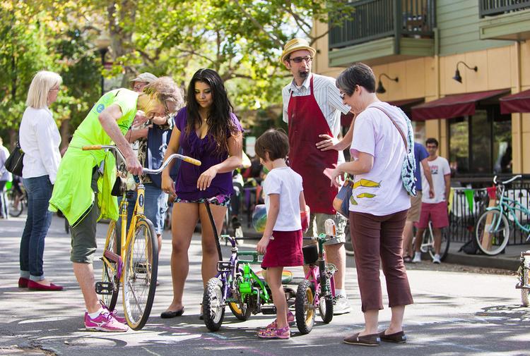 Trish Price helps with bike maintenance at Cool Davis Festival 2014