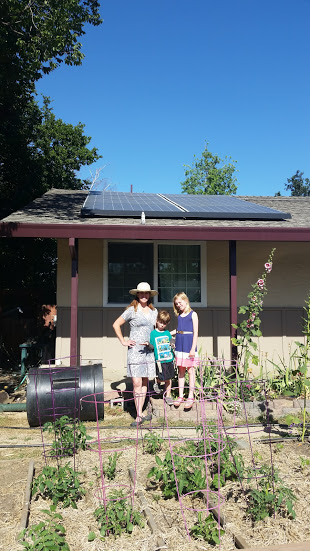 Backman Shobe Family Poses with Their Solar Panels