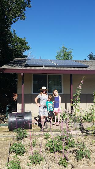 Backman Shobe Family Poses with Their Solar Panels