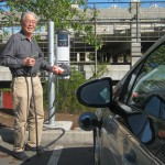 "UC Davis profesor Andy Frank, who has made hybrid electric and electric vehicles the focus of his career, demonstrates how to ""tank up"" his electric car."