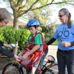 Christal Waters, left, and Trish Price of the Davis Bicycles! School Committee scan Alc Nelson's tag as he arrives safely last Friday at Willett elementary School.