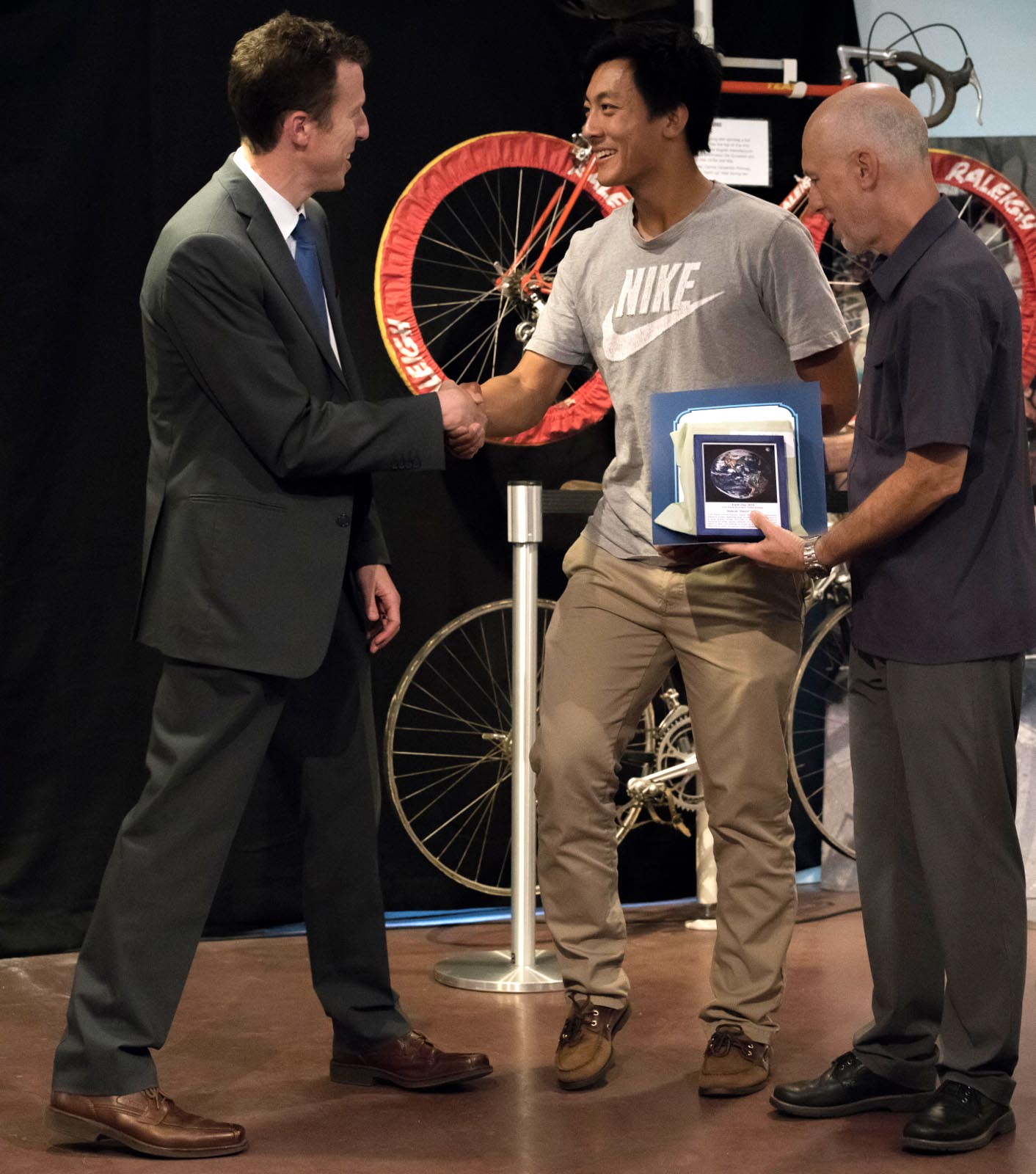 "MayMayor Dan Wolk congratulates Davis High School junior, Kaiyue ""David"" Wang. Cool Davis honored Kiayue for his development of a solar energy model, simulates solar irradiance received by solar panels installed on roofs, and allows users to learn the optimal tilt angle for solar panels, wherever they are on earth, by typing in the local latitude. or Dan Wolk congratulates Davis High School junior, Kaiyue ""David"" Wang. , while Councilman Robb Davis holds David's Cool Davis Eco-Hero award. Cool Davis honored Kiayue for his development of a solar energy model, simulates solar irradiance received by solar panels installed on roofs, and allows users to learn the optimal tilt angle for solar panels, wherever they are on earth, by typing in the local latitude. Kaiyue's award includes a framed picture of the Earth and Moon with a citation about his work and a certificate of recognition from both Senator Lois Wolk and Assemblyman Bill Dodd."