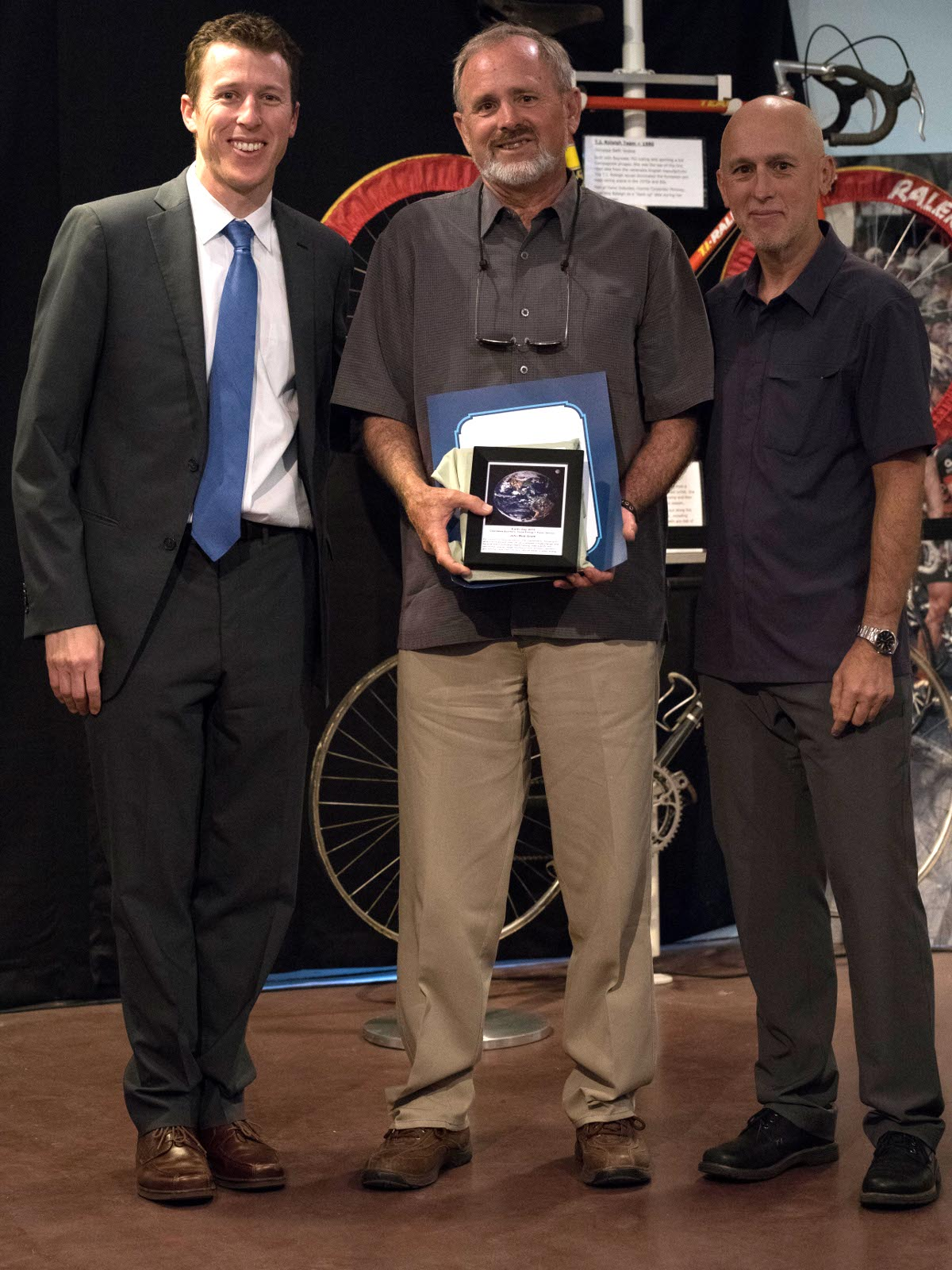 John Mott-Smith, flanked by Mayor Dan Wolk and Councilman Robb Davis, holds his Cool Davis Eco-hero award. Cool Davis honored John for his work in both energy efficiency and his out-standing public service. John's Davis Enterprise column, focuses on what individuals and municipalities can do to address climate change, and provides us with new ideas. His work as Yolo County's Climate Change Advisor and Yolo Energy Watch's Leader has helped cities quantify their energy usage and identify ways to reduce it. As John is also a founder of Cool Davis and a former board member, Cool Davis was especially pleased to name John a 2015 Eco-hero.