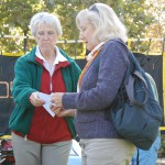 Beth Robbins explains the carbon tax to Sandy Weaver.
