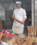 Joan Brown's photo of the bread-maker on the main thorough-fare to the climate meetings.