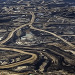 The tar sands mining destroys the boreal forest.