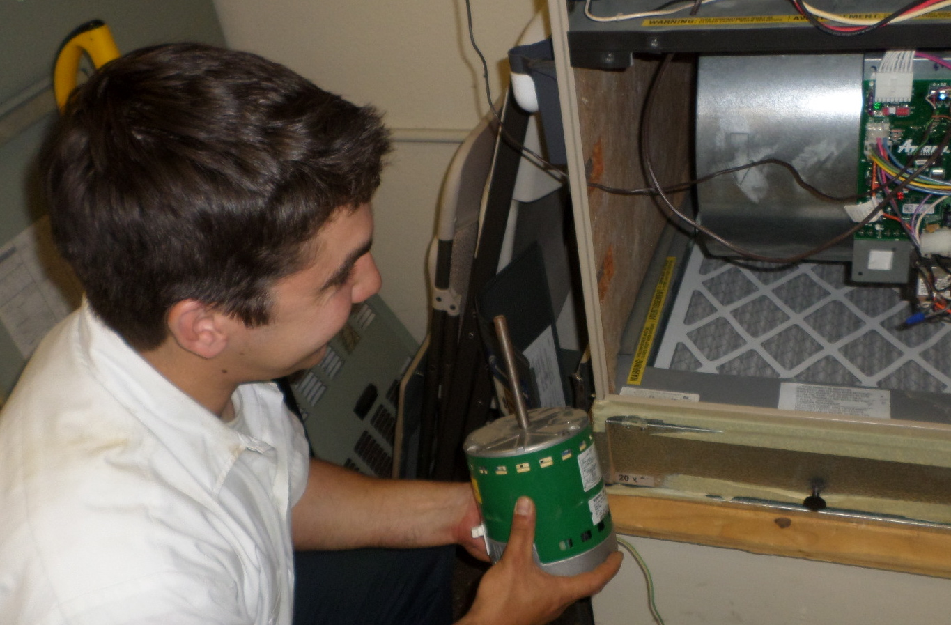 Cool davis partner greiner heating and air inc cool for How to install a blower motor in a furnace