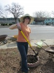 Leslie Crenna digs in at the Community Garden on Fifth Street
