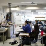 Students in Sherri Sandberg's Chemistry in the Community class listen to photojournalist Garth Lenz discuss his work. Sue Cockrell/Enterprise photo