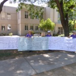 Yolo Move-On members paraded through Picnic Day 2015 with long lists of fracking chemicals.