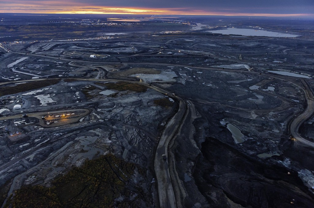 The tar sands oil glistens at night. Garth Lenz/Courtesy photo